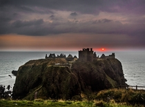 Sunrise on a rainy October morning at Dunnottar Castle in Stonehaven Scotland igjoeflask