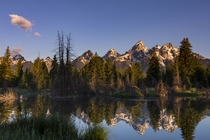 Sunrise on the Tetons reflected in a beaver pond