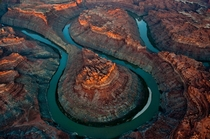 Sunrise over Colorado Rivers double oxbow Loop in Canyonlands Utah  Peter McBride