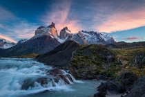 Sunrise over the Salto Grande cascades with the Cuernos del Paine mountains - in Torres del Paine national park Chile  by Jim Reitz