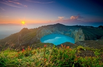 Sunrise over the surreal lake of the Kelimutu volcano on the Flores Island of Indonesia Photo by Shann Biglione