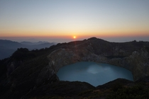 Sunrise over Volcanic Lakes which appear the consistency of paint at the summit of Gunung Kelimutu Flores Indonesia