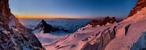 Sunrise panorama while climbing Mt Rainiers Disappointment Cleaver Route with views of Little Tahoma and Ingraham Glacier