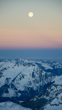 Sunrise snow mountains and the moon Taken from Schilthorn Switzerland