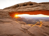Sunrise through Mesa Arch in Canyonlands Moab UT - Cliche location Probably Worth seeing Hell yes Id like to thank this subreddit for inspiring me to get out of the house