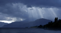 Suns rays breaking through a stormy sky nr Fort William Scotland