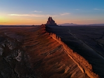 Sunset at Shiprock Ts Bita in Navajo a volcanic peak rising above the desert in northwestern New Mexico USA