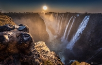 Sunset at the Victoria Falls ZambiaZimbabwe the worlds largest sheet of falling water  photo by Juan Ramn Jimnez
