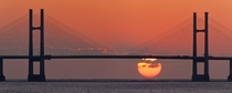 Sunset behind Severn Bridge Wales  by Clive Mowforth