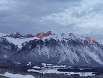 Sunset creating copper peaks in the Tyrol Mountains