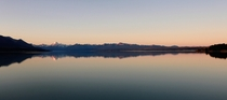 Sunset glow over calm lake and sky at Mount Cook Lake Pukaki New Zealand