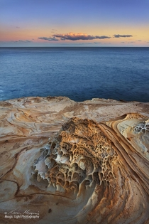 Sunset last night on the rocks at the northern end of Putty Beach in the Bouddi National Park in New South Wales Australia I love the colours shapes and patterns in the sandstone on this headland