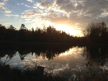 Sunset on a small pond at Huron National Forest Mio MI USA