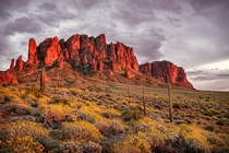 Sunset on the Superstition Mountains Apache Junction Arizona  by Michael Wilson