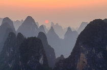 Sunset on top of Lao Zhai mountain at the bank of Li River China