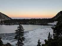 Sunset over half frozen Kathryn Lake high in the Pecos mountains of New Mexico   x