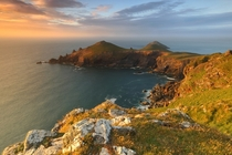 Sunset over the coastline of North Cornwall England known as The Rumps  by Gary King