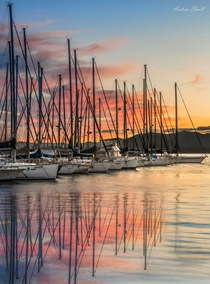 Sunset over the docks of Su Siccu Cagliari SardiniaItaly by Andrea Skull