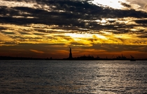 Sunset over the Statue of Liberty last December oc