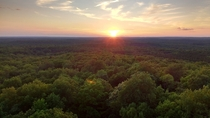 Sunset over the treetops of the Nicolet National Forest