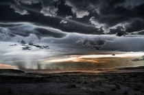 Sunset rain and dust storm at Petrified Forest National Park Arizona United States