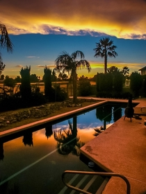 Sunset reflected in backyard pool - Yuma Arizona