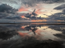 Sunset reflections at the beach Le Penon Seignosse in France OC
