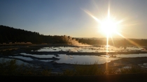 Sunset reflections over geyser pools Yellowstone National Park
