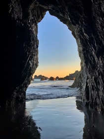 Sunset seen through a natural tunnel in Brookings OR