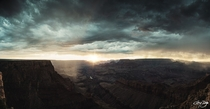 Sunset shining through the rain at the Grand Canyon South Rim