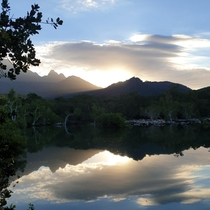 Sunset through Mount Bowen on Hinchinbrook Island national park in Queensland Australia