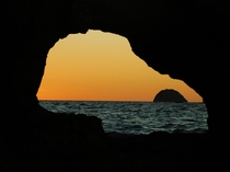 Sunset through natural window Mitsio Archipelago Madagascar
