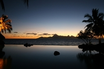 Sunset viewed from the infinity pool at a hotel in Papeete Tahiti French Polynesia photo by Remi Jordan