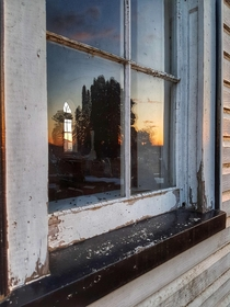 Sunset window reflection at an abandoned rural church in southeastern Ontario Canada  OC