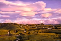 Superb pink lenticular clouds at sunset Alftavatn Iceland