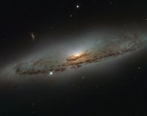 Supermassive and super-hungry - the spiral galaxy NGC  located over  million light-years away in the constellation of Virgo