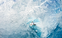 Surfer through a wave
