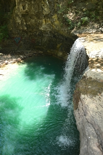 Surprisingly emerald waterfall in suburban Columbus Ohio