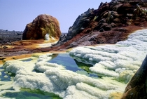 Surreal landscape at Dallol volcanic crater Ethiopia where hot springs are discharging brine and acid