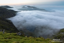 Surrounded by a cloud inversion at the top of Coniston Old Man The Lake District