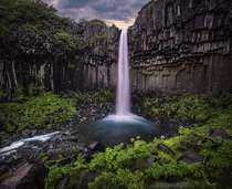 Svartifoss an Icelandic waterfall cutting through a columnar basalt formation  photo by freeezzzz x-post rIsland
