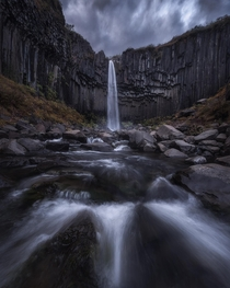 Svartifoss waterfall on a stormy day in Iceland  Insta seanhphotography