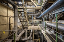 Symmetry and Organized Chaos in an Abandoned Paper Mill and Steam Plant OC x