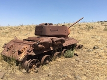 Syrian T-- abandoned in the Golan Heights after it fell to enemy fire in