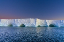 Tabular iceberg glowing in the Antarctic sunset