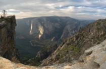 Taft Point Yosemite California with the sunlit cliffs of El Capitan in the distance