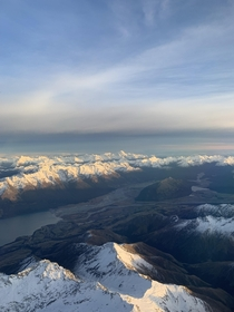 Taken from a plane to ZQN one of the most scenic approaches in the world Looking west toward Lake Wakatipu and the Southern Alps of New Zealand