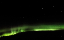 Taken ft in the sky of the big dipper underlined by the Aurora Borealis