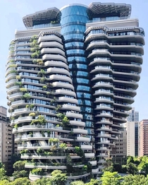 Tao Zhu Yin Yuan tower located in Taipei is an eco-designed energy-conserving and carbon-absorbing green building