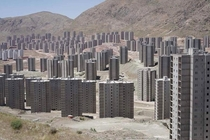 Tehrans Desert Ghost Towers look like a Zombie Movie Waiting to Happen